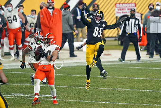 Cleveland Browns outside linebacker Sione Takitaki (44) intercepts a pass intended for Pittsburgh Steelers tight end Eric Ebron (85) during the second half of an NFL wild-card playoff football game, Sunday, Jan. 10, 2021, in Pittsburgh. (AP Photo/Keith Srakocic)