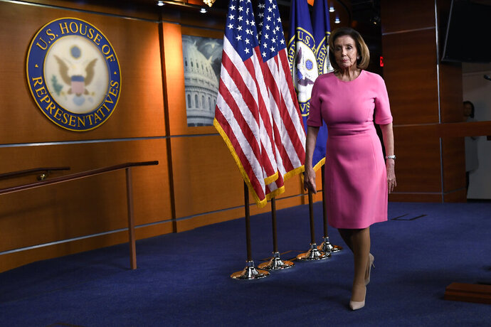 House Speaker Nancy Pelosi of Calif., walks off of the stage after speaking during a news conference on Capitol Hill in Washington, Thursday, March 26, 2020. (AP Photo/Susan Walsh)