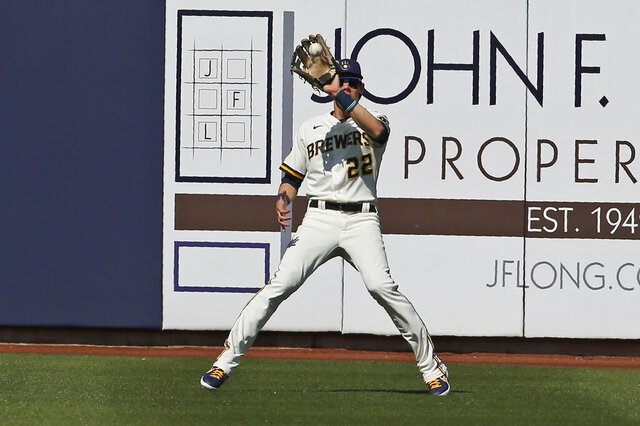 Milwaukee Brewers right fielder Christian Yelich (22) catches a fly ball hit by Los Angeles Angels' Jason Castro for an out in the fourth inning of a spring training baseball game, Sunday, March 8, 2020, in Phoenix. (AP Photo/Sue Ogrocki)