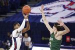 Gonzaga guard Joel Ayayi, left, shoots over San Francisco forward Dzmitry Ryuny during the first half of an NCAA college basketball game in Spokane, Wash., Saturday, Jan. 2, 2021. (AP Photo/Young Kwak)