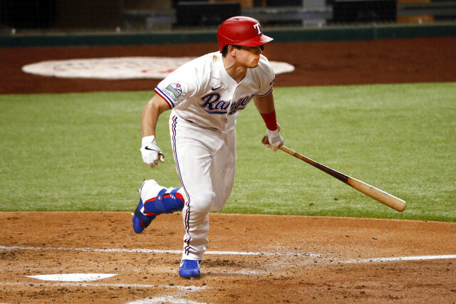 Texas Rangers' Nick Solak follows thru on a two-run single in the first inning of a baseball game against the Seattle Mariners in Arlington, Texas, Tuesday, Aug. 11, 2020. (AP Photo/Ray Carlin)