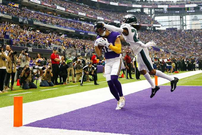 Minnesota Vikings wide receiver Adam Thielen catches a touchdown pass in front of Philadelphia Eagles cornerback Sidney Jones, right, during the first half of an NFL football game, Sunday, Oct. 13, 2019, in Minneapolis. (AP Photo/Bruce Kluckhohn)