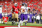 Northwestern running back Drake Anderson (6) scores a touchdown against Wisconsin safety Eric Burrell (25) and linebacker Chris Orr (54) during the second half of an NCAA college football game Saturday, Sept. 28, 2019, in Madison, Wis. Wisconsin won 24-15. (AP Photo/Andy Manis)
