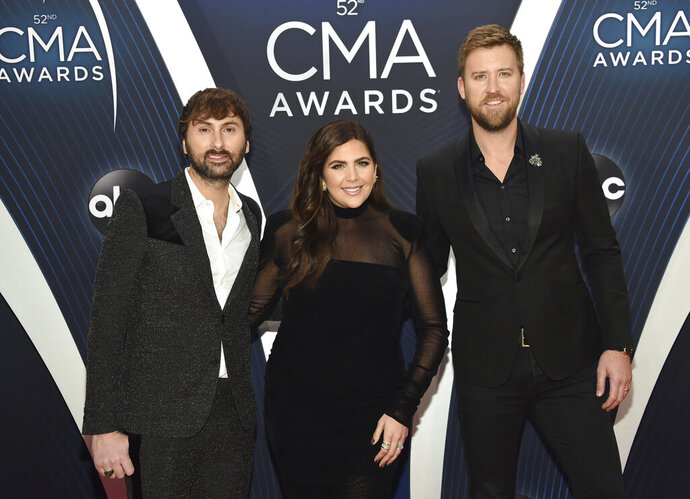FILE - In this Nov. 14, 2018 file photo, Dave Haywood, from left, Hillary Scott and Charles Kelley, of Lady A, formerly Lady Antebellum, arrive at the 52nd annual CMA Awards in Nashville, Tenn. The Grammy-winning country group, which dropped the word
