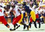 Maryland quarterback Kasim Hill (11) is brought down by Michigan linebacker Khaleke Hudson (7) in the first half of an NCAA football game in Ann Arbor, Mich., Saturday, Oct. 6, 2018. (AP Photo/Paul Sancya)