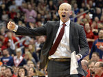 Louisville head coach Chris Mack argues a call during the second half of an NCAA college basketball game against Virginia in Louisville, Ky., Saturday, Feb. 23, 2019. Virginia won 64-52. (AP Photo/Timothy D. Easley)right