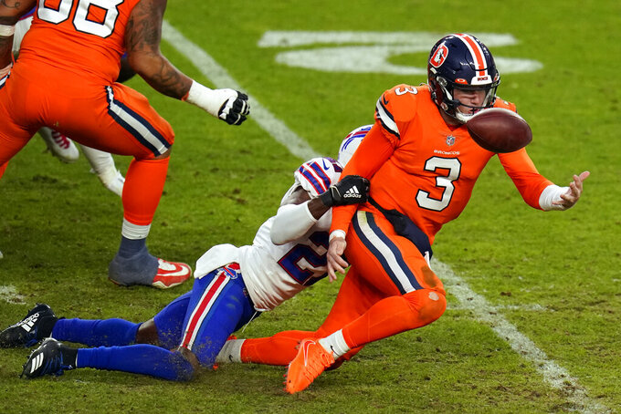 Denver Broncos quarterback Drew Lock fumbles the ball as he is hit by Buffalo Bills cornerback Tre'Davious White during the second half of an NFL football game Saturday, Dec. 19, 2020, in Denver. (AP Photo/Jack Dempsey)
