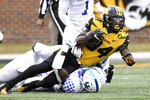 Missouri running back Larry Rountree III, top, is stopped by Kentucky defensive back Yusuf Corker during the second half of an NCAA college football game Saturday, Oct. 24, 2020, in Columbia, Mo. (AP Photo/L.G. Patterson)