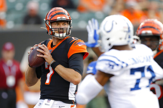 Cincinnati Bengals quarterback Jake Dolegala (7) looks to pass during the first half of the team's NFL preseason football game against the Indianapolis Colts, Thursday, Aug. 29, 2019, in Cincinnati. (AP Photo/Gary Landers)