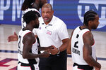 Los Angeles Clippers head coach Doc Rivers, center, talks with Los Angeles Clippers' Patrick Beverley (21) after their win over the Denver Nuggets in an NBA conference semifinal playoff basketball game Monday, Sept. 7, 2020, in Lake Buena Vista, Fla. (AP Photo/Mark J. Terrill)