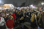 Alabama fans celebrate in the street in Tuscaloosa, Ala., Monday night, Jan. 11, 2021, after Alabama defeated Ohio State 52-24 in the NCAA college football national championship game in Miami Gardens, Fla. Many of the fans didn't take basic precautions against the coronavirus like wearing face masks. (Benjamin Flanagan/Alabama Media Group via AP)