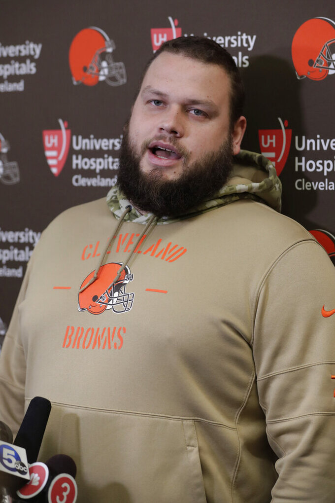 Cleveland Browns offensive guard Joel Bitonio speaks to the media at the NFL football team's training camp facility, Monday, Dec. 30, 2019, in Berea, Ohio. Head coach Freddie Kitchens was dismissed shortly after the Browns returned to team headquarters following a 33-23 loss to the lowly Cincinnati Bengals. (AP Photo/Tony Dejak)