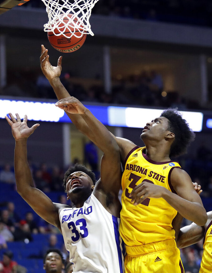 Arizona State's De'Quon Lake and Buffalo's Nick Perkins (33) reach for a rebound during the second half of a first round men's college basketball game in the NCAA Tournament Friday, March 22, 2019, in Tulsa, Okla. (AP Photo/Jeff Roberson)