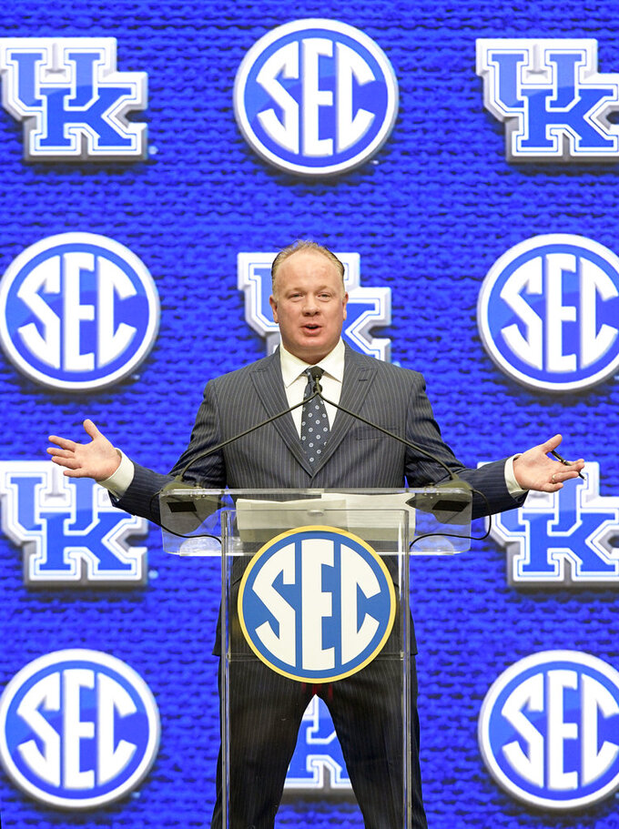 FILE - In this July 16, 2018, file photo, Kentucky head coach Mark Stoops speaks during NCAA college football Southeastern Conference media days at the College Football Hall of Fame in Atlanta. Stoops is the coach of the year on The Associated Press All-Southeastern Conference team, announced Monday, Dec. 3, 2018. (AP Photo/John Amis, File)