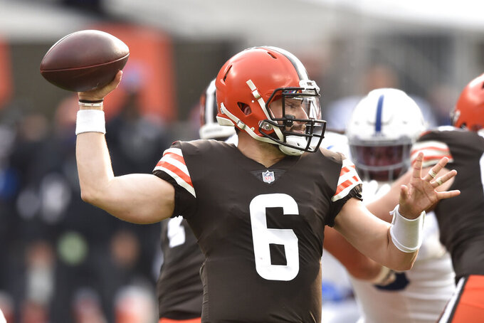 Cleveland Browns quarterback Baker Mayfield throws during the first half of an NFL football game against the Indianapolis Colts, Sunday, Oct. 11, 2020, in Cleveland. (AP Photo/David Richard)