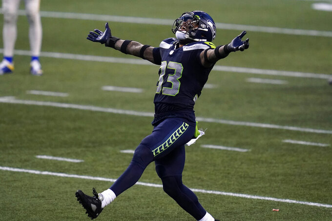 Seattle Seahawks strong safety Jamal Adams (33) reacts to a play against the Los Angeles Rams during the second half of an NFL football game, Sunday, Dec. 27, 2020, in Seattle. The Seahawks won 20-9. (AP Photo/Elaine Thompson)