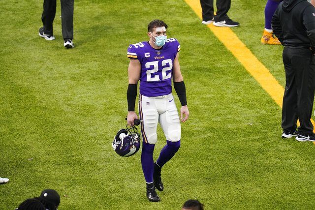 Minnesota Vikings safety Harrison Smith walks on the sideline during the second half of an NFL football game against the Chicago Bears, Sunday, Dec. 20, 2020, in Minneapolis. The Bears won 33-27. (AP Photo/Charlie Neibergall)