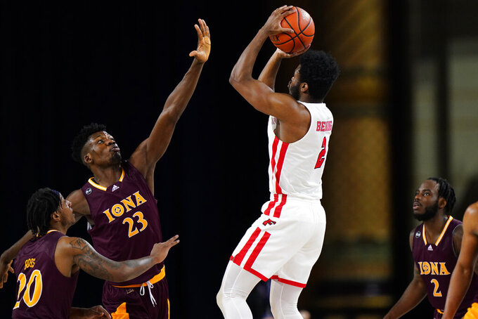Fairfield's Taj Benning (2) goes up for a shot against Iona's Nelly Junior Joseph (23), Isaiah Ross (20) and Asante Gist (2) in the first half of an NCAA college basketball game during the finals of the Metro Atlantic Athletic Conference tournament, Saturday, March 13, 2021, in Atlantic City, N.J. (AP Photo/Matt Slocum)