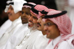 Saudis smiles during a press conference after Energy Minister Prince Abdulaziz bin Salman announced that 50% of its daily crude oil production that was knocked out by a weekend attack had been restored during a press conference in Jiddah, Saudi Arabia, Tuesday, Sept. 17, 2019. (AP Photo/Amr Nabil)