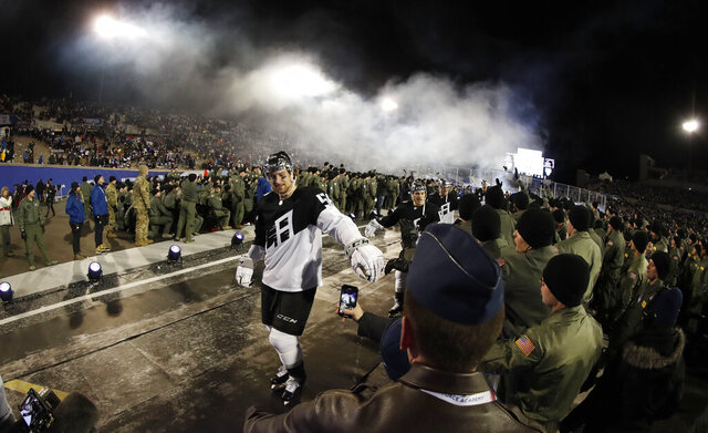 Los Angeles Kings defenseman Kurtis MacDermid is congratulated by cadets while heading back to the locker room after the team's NHL hockey game against the Colorado Avalanche on Saturday, Feb. 15, 2020, at Air Force Academy, Colo. The Kings won 3-1. (AP Photo/David Zalubowski)