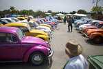 FILE- In this April 21, 2017, file photo Volkswagen Beetles are displayed during the annual gathering of the