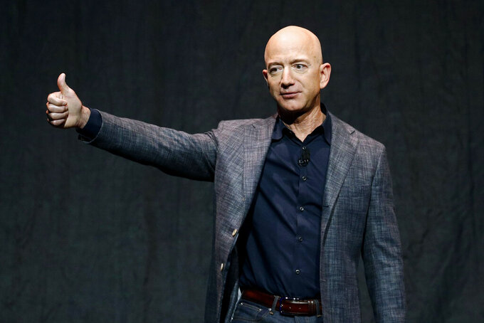 FILE - In this Thursday, May 9, 2019, file photo, Jeff Bezos speaks at an event before unveiling Blue Origin's Blue Moon lunar lander, in Washington. The price to rocket into space next month with Bezos and his brother is a cool $28 million. That was the winning bid during the live online auction Saturday, June 12, 2021. (AP Photo/Patrick Semansky, File)