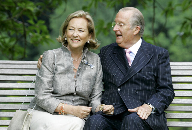 FILE - In this Tuesday, July 17, 2008 file photo, Belgium's Queen Paola and King Albert II pose for photographers at the Royal Palace in Laeken, Belgium. After years of legal fights, a decades-old royal paternity scandal saw a major breakthrough Monday, Jan. 27, 2020, Belgium's former King Albert II is no longer fighting a claim that he is the father of artist and sculptor Delphine Boel. (AP PhotoVirginia Mayo, File)