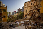 Damaged buildings are seen in a neighborhood near the site of last week's explosion that devastated the seaport of Beirut Beirut, Lebanon, Wednesday, Aug. 12, 2020. (AP Photo/Hassan Ammar)