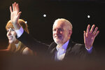 Labour Party leader Jeremy Corbyn and shadow education secretary Angela Rayner acknowledge supporters at the Grand Central Hall in Liverpool, England, on Saturday Oct. 19, 2019, after the Letwin amendment, which seeks to avoid a no-deal Brexit on October 31, was accepted by the House, following Prime Minister Boris Johnson's statement in the House of Commons over his new Brexit deal. (Danny Lawson/PA via AP)