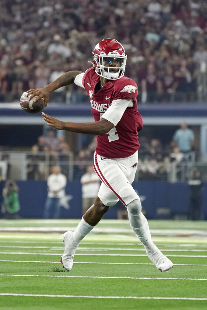Arkansas quarterback Malik Hornsby throws a pass in the second half of an NCAA college football game against Texas A&M in Arlington, Texas, Saturday, Sept. 25, 2021. (AP Photo/Tony Gutierrez)