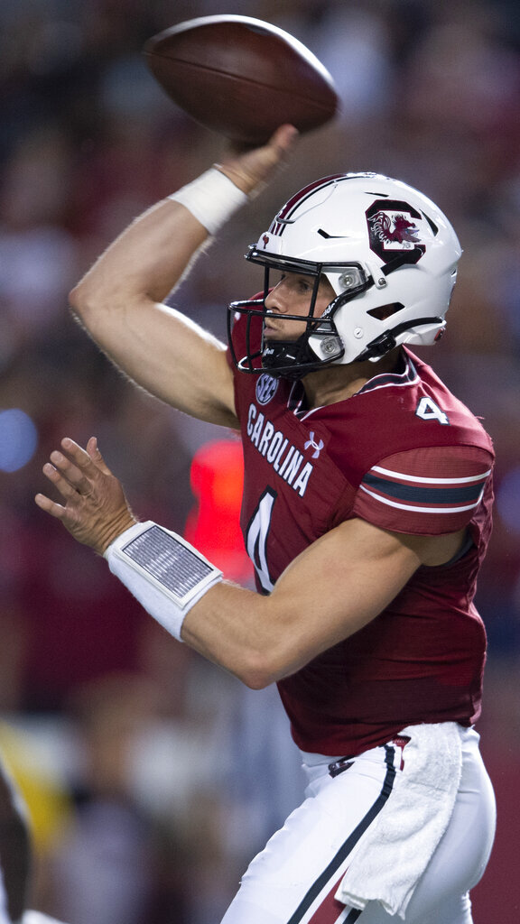 South Carolina quarterback Luke Doty (4) attempts a pass in the first half of an NCAA college football game against Kentucky, Saturday, Sept. 25, 2021, at Williams-Brice Stadium in Columbia, S.C. (AP Photo/Hakim Wright Sr.)