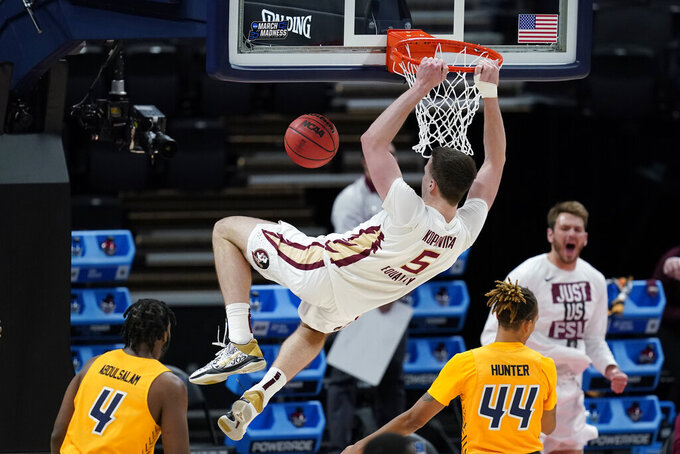 Florida State's Balsa Koprivica (5) dunks during the second half of a first-round game against UNC-Greensboro in the NCAA men's college basketball tournament at Banker's Life Fieldhouse, Saturday, March 20, 2021, in Indianapolis. (AP Photo/Darron Cummings)