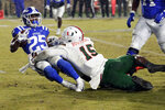 FILE - In this Nov. 30, 2019, file photo, Miami's Gregory Rousseau (15) tackles Duke's Deon Jackson (25) during the second half of an NCAA college football game between Miami and Duke in Durham, N.C. Rousseau was selected to The Associated Press preseason All-America first-team, Tuesday, Aug. 25, 2020. (AP Photo/Chris Seward, File)