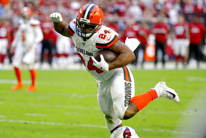 Cleveland Browns running back Nick Chubb (24) runs for a touchdown against the Arizona Cardinals during the first half of an NFL football game, Sunday, Dec. 15, 2019, in Glendale, Ariz. (AP Photo/Rick Scuteri)