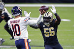 Chicago Bears quarterback Mitchell Trubisky passes under pressure from New Orleans Saints outside linebacker Demario Davis (56) in the first half of an NFL wild-card playoff football game in New Orleans, Sunday, Jan. 10, 2021. (AP Photo/Butch Dill)