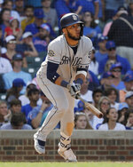 San Diego Padres' Fernando Tatis Jr., watches his two-run single during the ninth inning of a baseball game against the Chicago Cubs in Chicago, Sunday, July 21, 2019. (AP Photo/Nam Y. Huh)