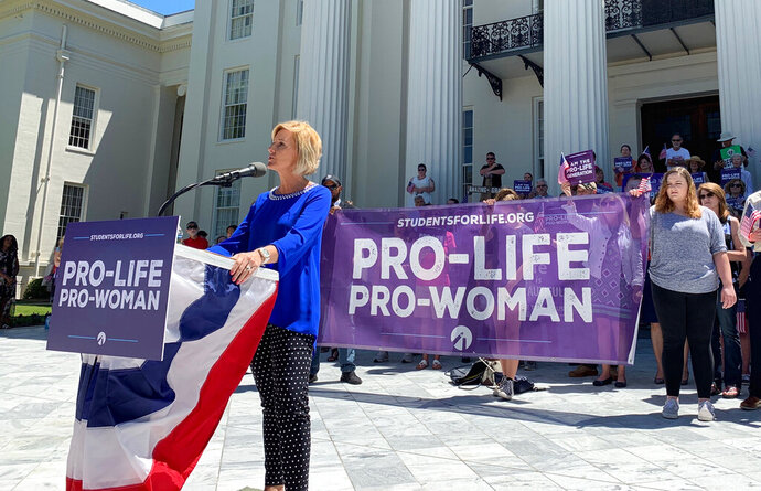 FILE - In this Wednesday, May 22, 2019, file photo, Beck Gerritson, president of Eagle Forum of Alabama, speaks at an anti-abortion rally outside the Capitol in Montgomery, Ala. Even as the anti-abortion movement celebrates passage of sweeping bans in several states, a rift is widening between activists who oppose exceptions for rape and incest, and other abortion opponents, including many Republican politicians, who support those exceptions. (AP Photo/Kim Chandler, File)