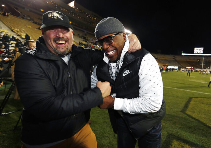 Former Colorado wide receiver Blake Anderson, left, jokes with former quarterback Kordell Stewart before an NCAA college football game between Washington and Colorado on Saturday, Nov. 23, 2019, in Boulder, Colo. (AP Photo/David Zalubowski)