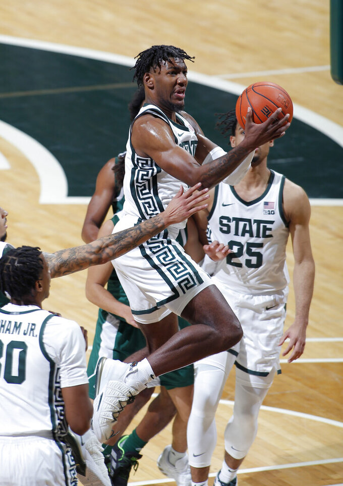 Michigan State's Aaron Henry goes up for a layup against Eastern Michigan during the first half of an NCAA college basketball game Wednesday, Nov. 25, 2020, in East Lansing, Mich. (AP Photo/Al Goldis)