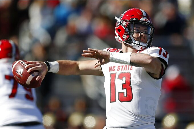 North Carolina State quarterback Devin Leary (13) passes against Boston College during the first half of an NCAA college football game in Boston, Saturday, Oct. 19, 2019. (AP Photo/Michael Dwyer)