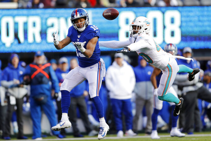 New York Giants wide receiver Golden Tate (15) makes a catch on his way to score a touchdown in front of Miami Dolphins defensive back Nik Needham (40) during the first half of an NFL football game, Sunday, Dec. 15, 2019, in East Rutherford, N.J. (AP Photo/Adam Hunger)