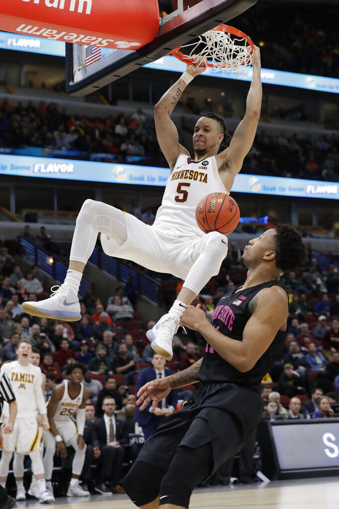 Minnesota's Amir Coffey (5) duns over Penn State's Lamar Stevens (11) during the second half of an NCAA college basketball game in the second round of the Big Ten Conference tournament, Thursday, March 14, 2019, in Chicago. (AP Photo/Nam Y. Huh)