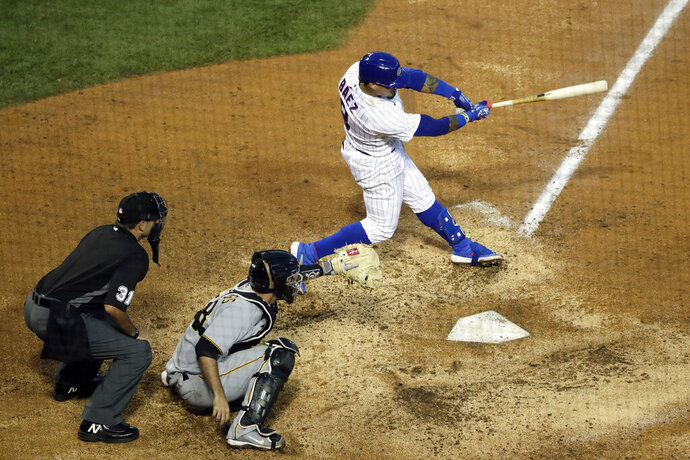 Chicago Cubs' Javier Baez, right, hits a winning single during the 11th inning of a baseball game against the Pittsburgh Pirates in Chicago, Sunday, Aug. 2, 2020. (AP Photo/Nam Y. Huh)
