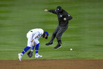 The second base umpire, right, avoids the ball as Toronto Blue Jays shortstop Bo Bichette, left, cannot get to a single hit by New York Yankees' Gio Urshela during the ninth inning of a baseball game in Buffalo, N.Y., Monday, Sept. 21, 2020. (AP Photo/Adrian Kraus)