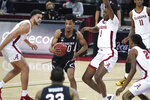 South Carolina guard AJ Lawson (00) drives between Alabama forward Herbert Jones (1) and Alex Reese, left, during the first half of an NCAA college basketball game Tuesday, Feb. 9, 2021, in Columbia, S.C. (AP Photo/Sean Rayford)