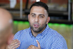 Food blogger Abraham Obeid is interviewed, Wednesday, Oct. 28, 2020, in Dearborn, Mich. Obeid is asked about his friend, Detroit Lions offensive guard Oday Aboushi. NFL players have kneeled during the anthem and have made stands to protest social injustice, but none have done it in quite the same way as Aboushi. He wants to use his platform to shed light on what he says is Israel's oppression of the Palestinians and to promote religious harmony as a Muslim with friends of different faiths. (AP Photo/Carlos Osorio)