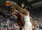 Mississippi State guard Nick Weatherspoon (0) struggles to pass the ball away from Alabama guard Herbert Jones (10) during the first half of an NCAA college basketball game, Tuesday, Jan. 29, 2019, in Tuscaloosa, Ala. (AP Photo/Vasha Hunt)