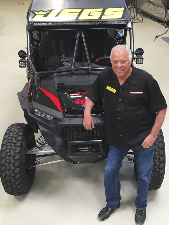 This photo provided by Don Prudhomme Racing shows Don Prudhomme posed at his shop in Vista, Calif., in March 2018. Don Prudhomme had no clue what he was doing the first time he entered the Baja 1000. The legendary drag racer made it about 100 miles before blowing an engine. Now, 50 years later, he gets to try again. The 77-year-old Prudhomme will return to Baja for the Mexican 1000 next week, his first competitive race since retiring from NHRA in 1994. (Donna Prudhomme/Don Prudhomme Racing via AP)