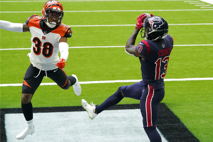 Houston Texans wide receiver Brandin Cooks (13) catches a pass for a touchdown as Cincinnati Bengals cornerback LeShaun Sims (38) defends during the first half of an NFL football game Sunday, Dec. 27, 2020, in Houston. (AP Photo/Sam Craft)