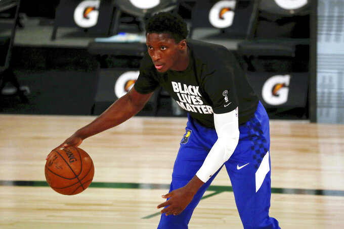 FILE - In this Aug. 10, 2020, file photo, Indiana Pacers guard Victor Oladipo warms up for an NBA basketball game against the Miami Heat in Lake Buena Vista, Fla. While Oladipo's future with the Pacers remains murky, his investments become clearer every day. Oladipo and business manager Jay Henderson have joined a group that includes former Florida basketball player Matt Walsh to purchase the New Zealand Breakers of the Australian National Basketball League. (Kim Klement/Pool Photo via AP, File)